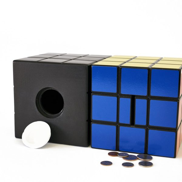 Uniquely Geek Rubrics Cube coin bank staged open with change both sides