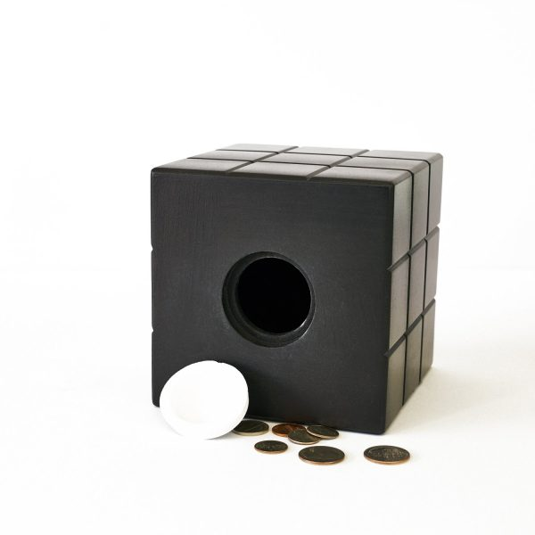 Uniquely Geek Rubrics Cube coin bank staged open with change