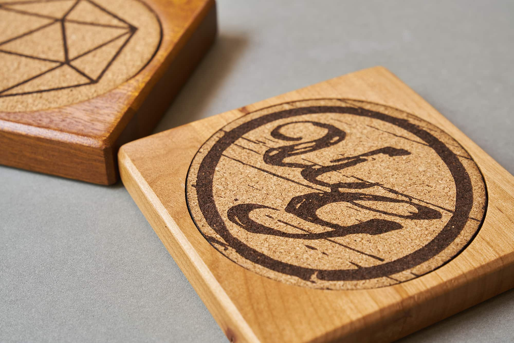 Cork surface inserts for custom hardwood coasters by Uniquely Geek